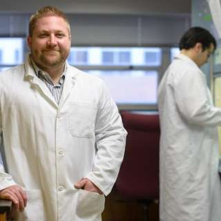 Rob Huigens poses in his lab